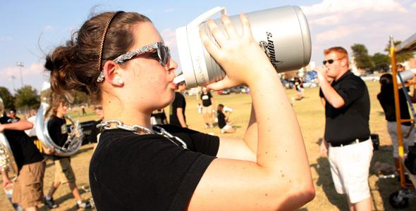 Drum Major Lydia White takes a water break during summer band.