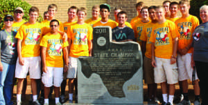 The Rider baseball team, coaches and administrators stand before the state monument that they earned this summer for winning the 4A State Cahmpionship. The monument was delivered to Rider in September.