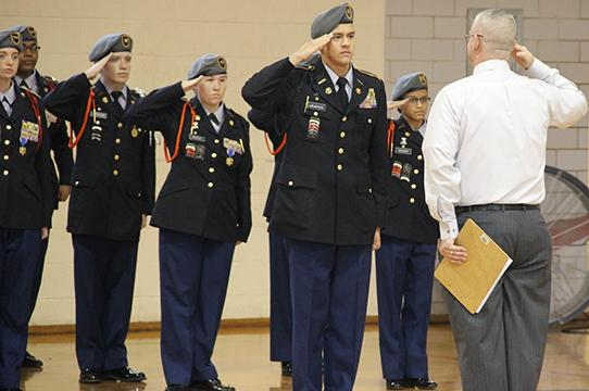 JROTC Executive Officer Austin Laughlin salutes the inspector at the JROTC inspection Dec. 9. The inspection is usually in April. In spite of the early date the group met requirements with a satisfactory score.