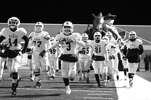The Raiders run on to the field before a game.