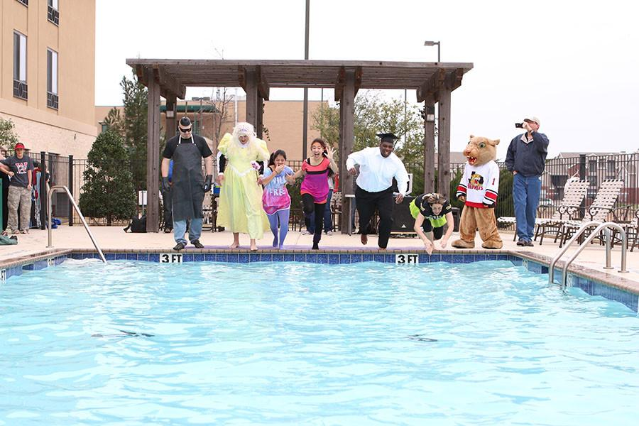 Rider's group for the 2015 Polar Plunge leaps into the pool at the Holiday Inn with temperatures reaching down into the 40s. Participants (from left to right) include Mr. Nielsen, Coach Bobbitt, Karla Alvarado, Karla Gonzalez, Coach Francis, and Mrs. Wood.