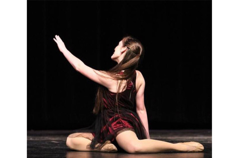 """""""I take dance more seriously now because I found a way to express myself."""" Senior Peyton Tally finishes her solo at competition, spring 2015."""
