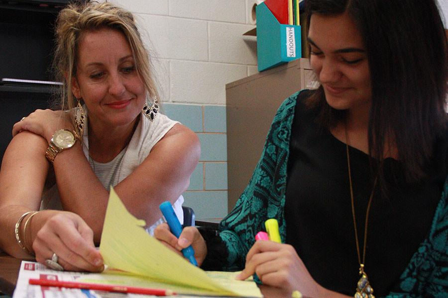 Mrs. Wood  works with sophomore Taryn Bass on her timed writing.