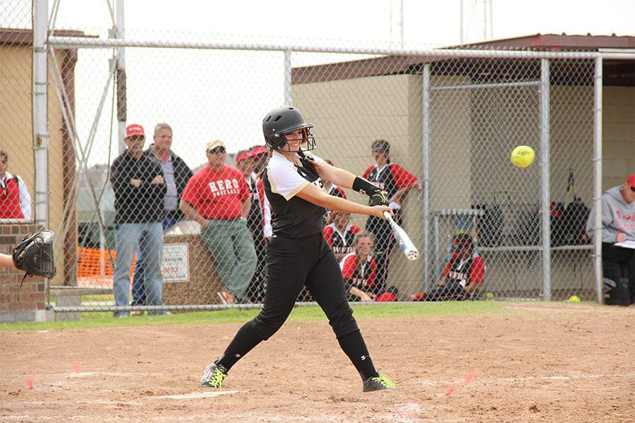 With a 19-1 victory, senior Megan Barmore hits a single against Old High.
