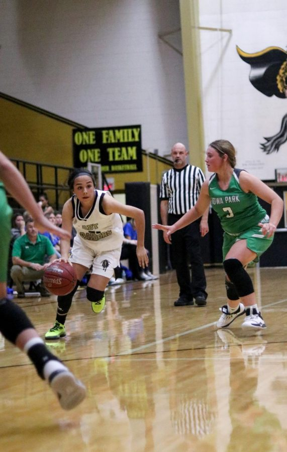 Freshman point guard Ashlynn Knight plays against Iowa Park.