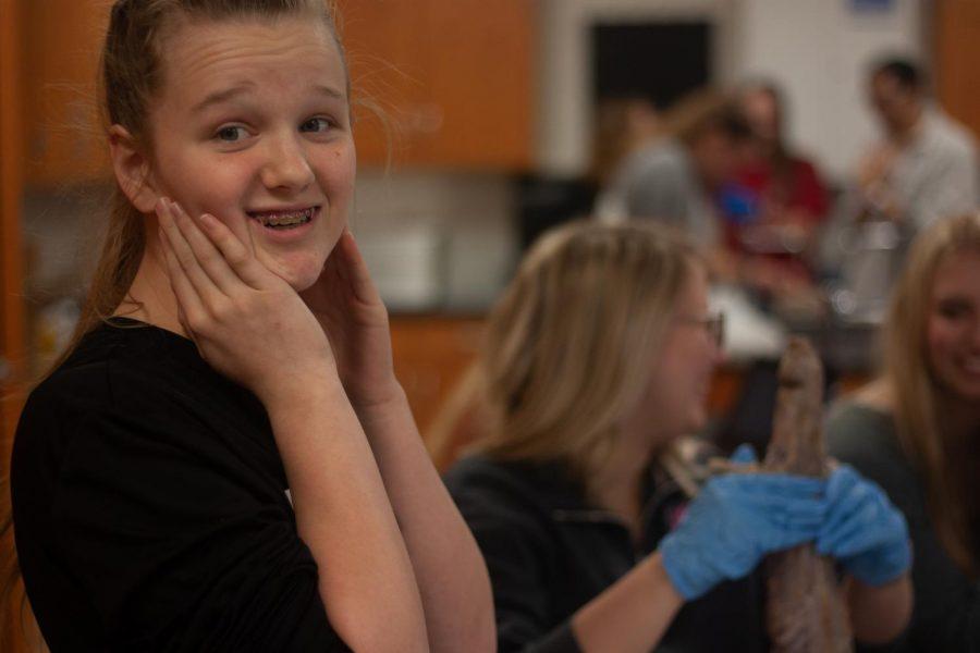 Kaitlyn Dunlap dissecting a mink.