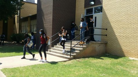 Students return to campus following safety procedures amid the coronavirus pandemic.