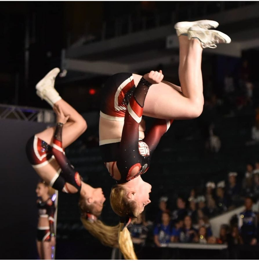 Bella Kelleher competes with her competitive cheer team