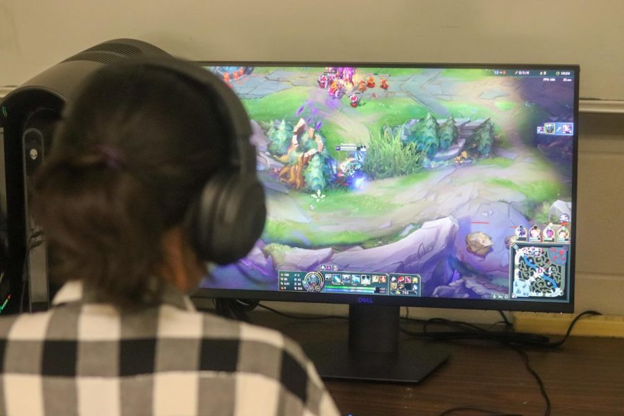 Val Valencia playing League of Legends during esports.