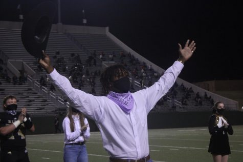 Senior Arman Persaud thanks the crowd after being named Mr. Raider 2020 at the Canyon Randall football game on Nov. 20.