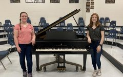 Amberly Schell, left, and Maranda Rose-Adame, right, pose infront of a piano after achieving All-State titles