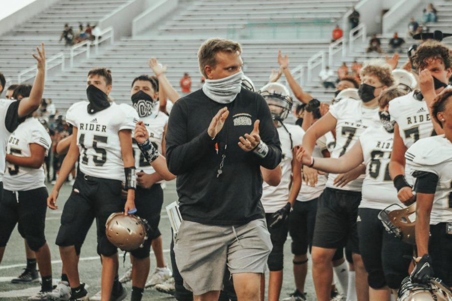 Head coach Marc Bindel observing the 2020 freshman season.