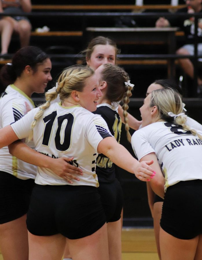 The Lady Raiders celebrate earning a point in a non-district match.