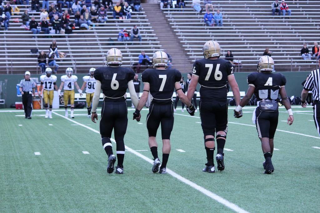 The captains walking onto the field before the 9/14 game against Amarillo.
