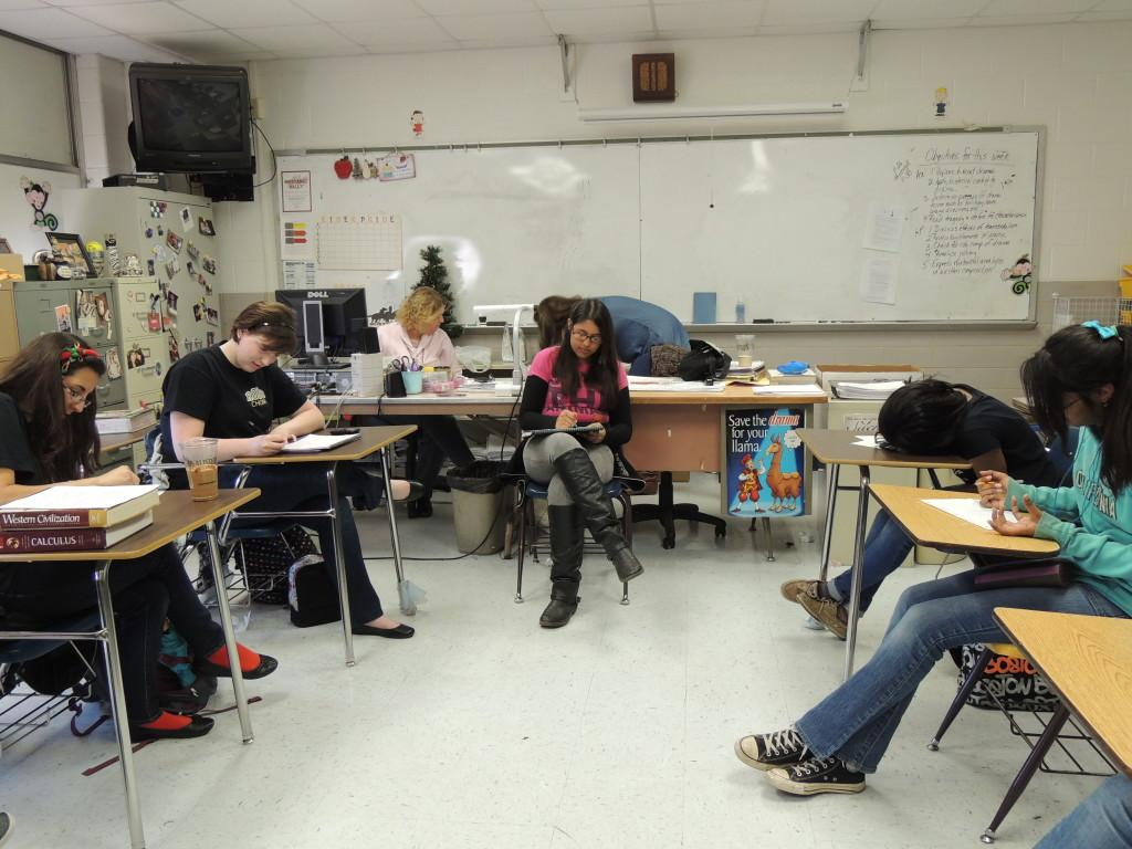 Creative writing students drawing a picture of a house for a prompt.