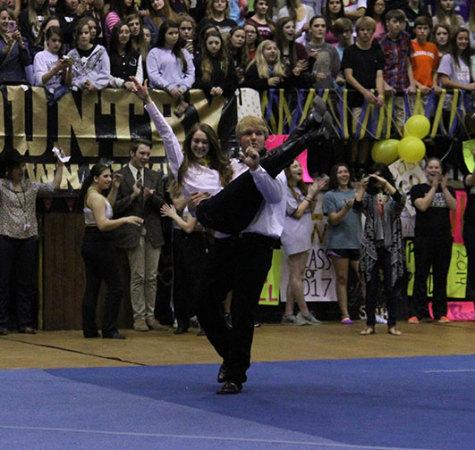 Mr. Raider RD Wegmann dances with his partner, Raider nominee Georgia DuBose at the Round-Up Assembly.