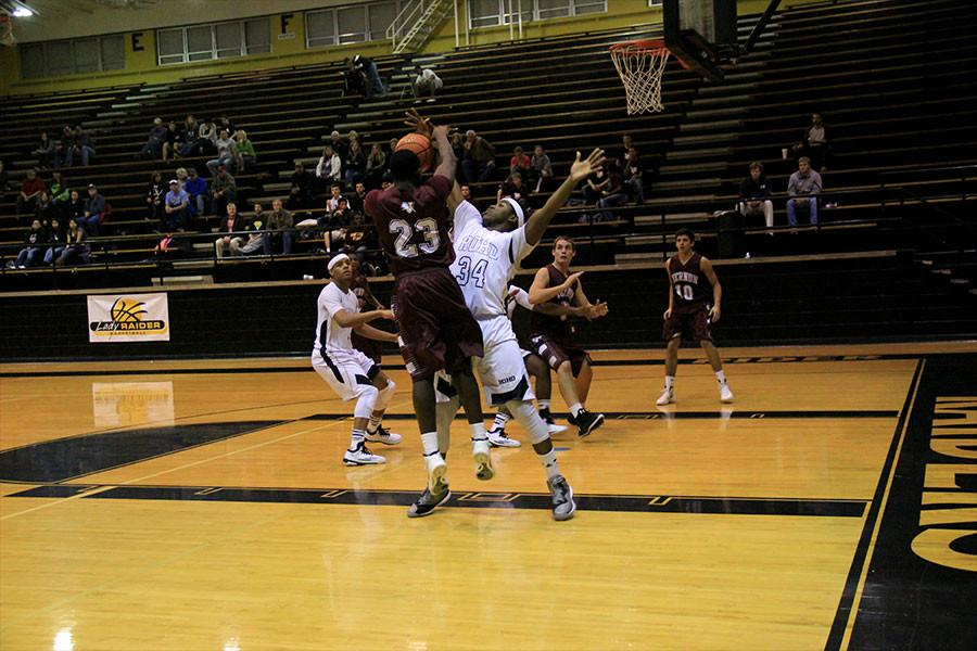 Senior Brien Howard defends against a player from Vernon as the offense shoots for two.