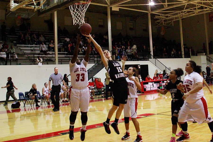 Junior Rachel Richie shoots a lay-up during a game against Old High.