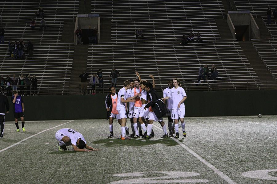 Teammates run onto the field after Peloquins buzzer beating goal