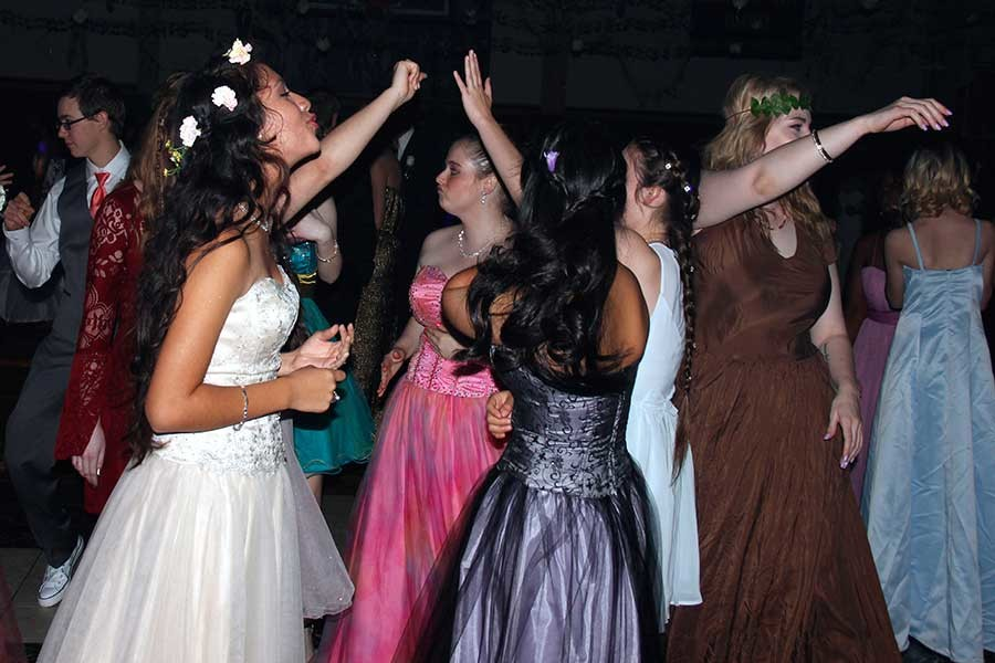 Junior Karla Gonzalez dances with her best friend Karla Alvarado in the middle of the dance floor at prom