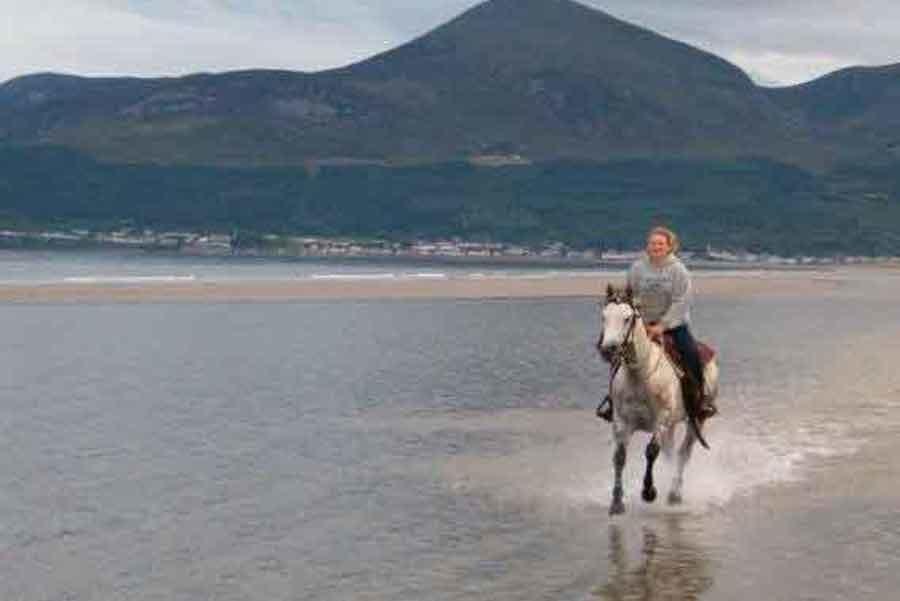 Chemistry teacher Autumn Weber rides a horse during a trip in Ireland.