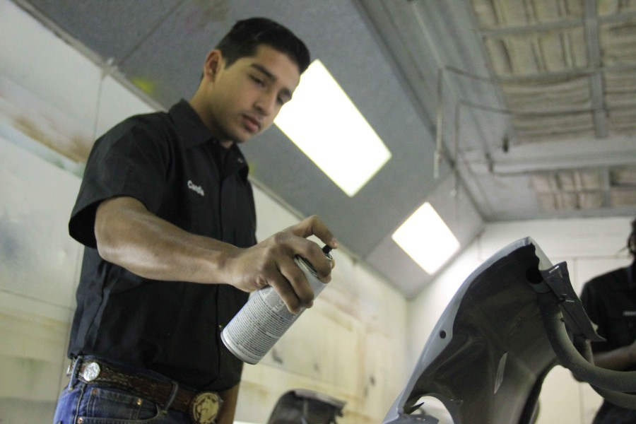 Juan Candia works in auto body at Carrigan