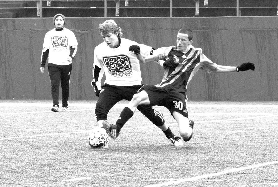 Senior Russell Catletti plays against former Rider students at the Alumni vs. Varsity game