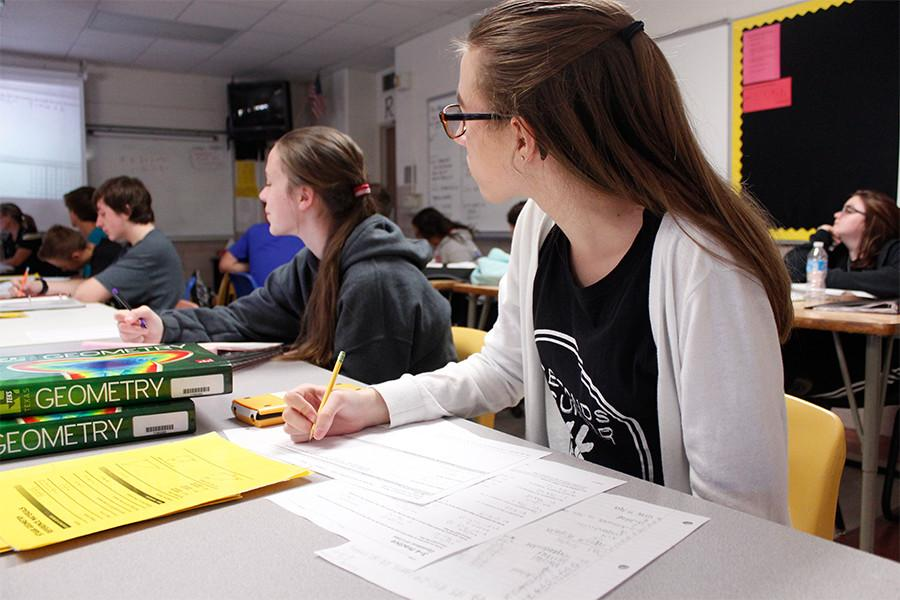 """In pre-AP Geometry, freshman Brooke Inman works in Mrs. Wuthrich's third period class. """"I like how we get to use calculators,"""" she said. """"She really tries to help us when we don't understand stuff."""""""