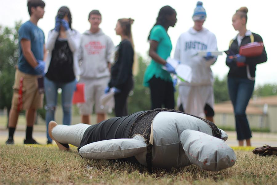"""Forensic Science make digital composite sketches. """"I took this class because I plan on majoring in Forensics when I go to college,"""" senior Trace Gauthier said. """"The crime scenes are my favorite."""""""