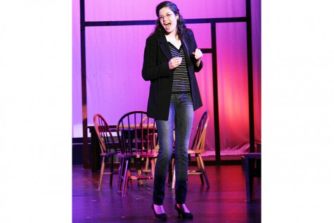 """Standing center stage, Junior Katie McGinn continues her role as stage manager in 'Our Town'. """"The stage manager provides insight on and being a human being and living."""""""
