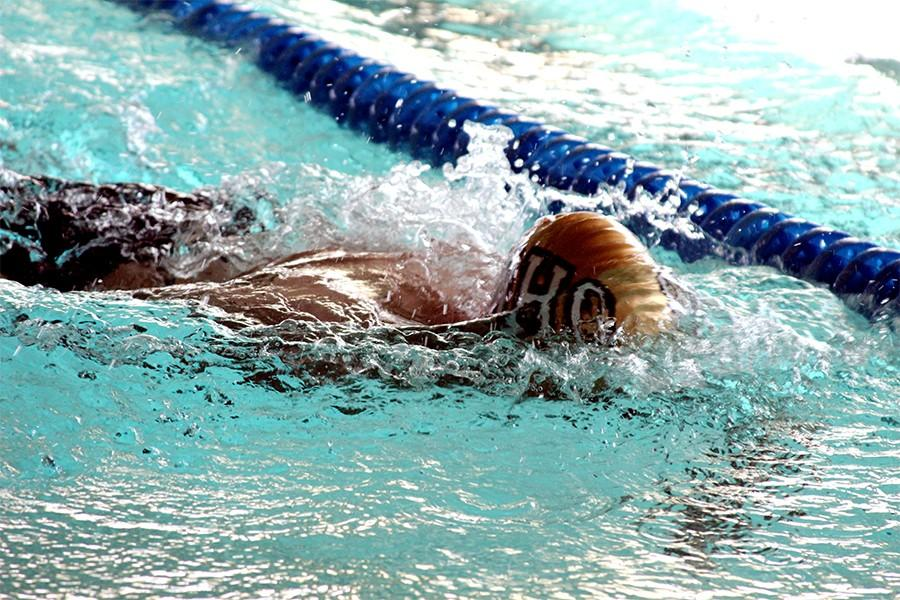 Sophomore Brandon Malone turns during the 200-yard Individual Medley against Decatur High School.