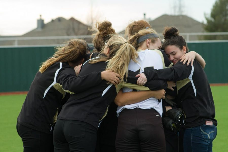 After+winning+their+first+game+with+Coach+Graves+as+the+leader%2C+the+girls+embrace+each+other.