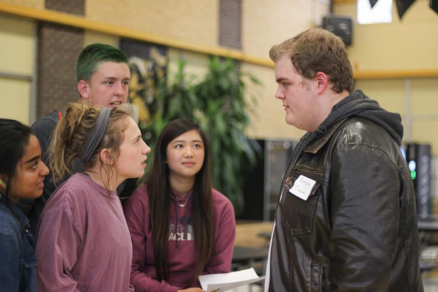 Seniors Jaycee Bruner, Vy Phan, Carson Lee and junior Zayanna Uddin question sophomore Ben Hill, who is playing Enrique Groves, about the murderer.