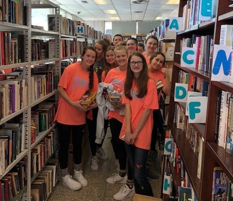 Student Council members volunteering with Friends of the Public Library on Teens Make a Difference Day.