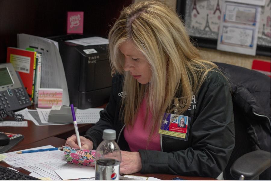 Amanda Mann working at her desk.
