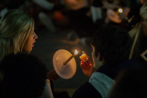 Rider students light candles at last year's The Happening.