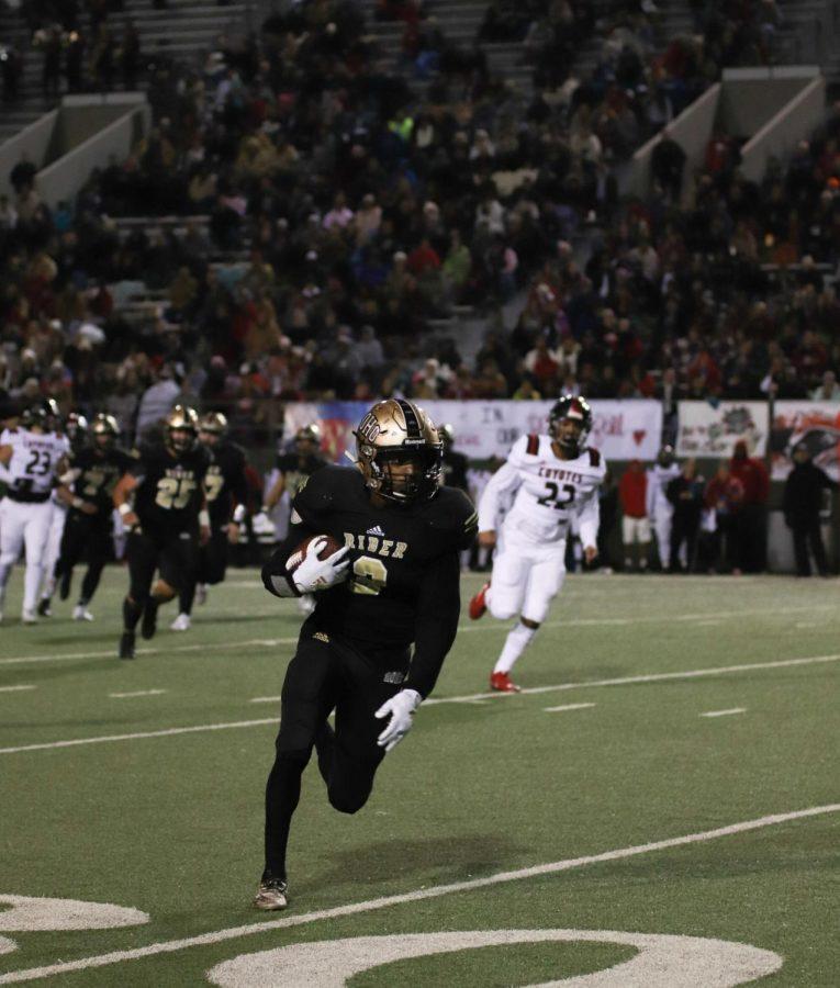 A Raider grabs the ball a runs to score a touchdown