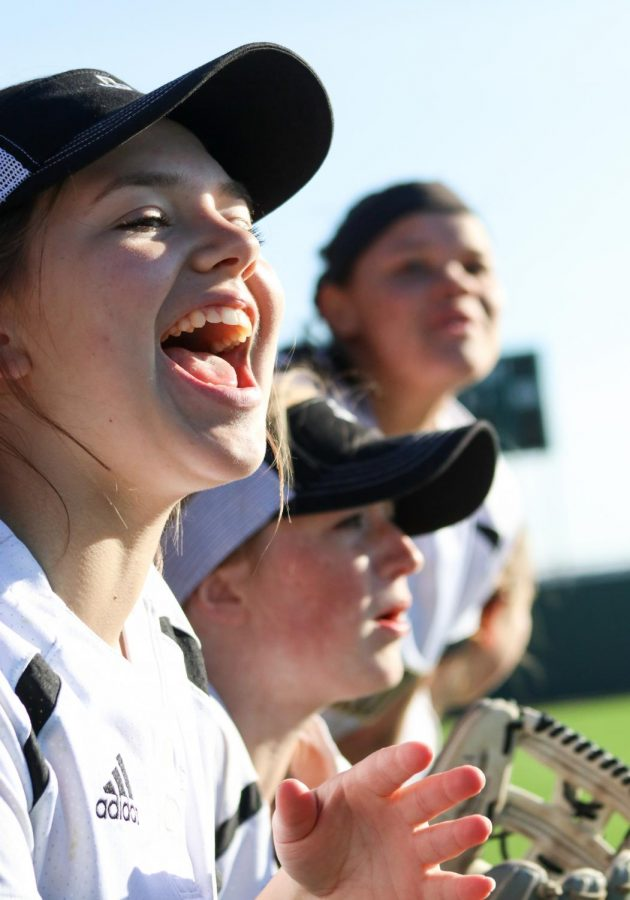 Sophomore Olivia Wall cheering for her teammates from the sidelines.