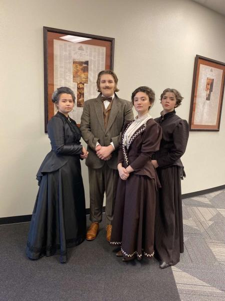 Sam Eytalis (Last person on the right) stands with other actors in their costumes for the UIL show.