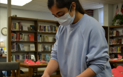 Manasvi Reddy makes candy grams during a Student Council activity in February.