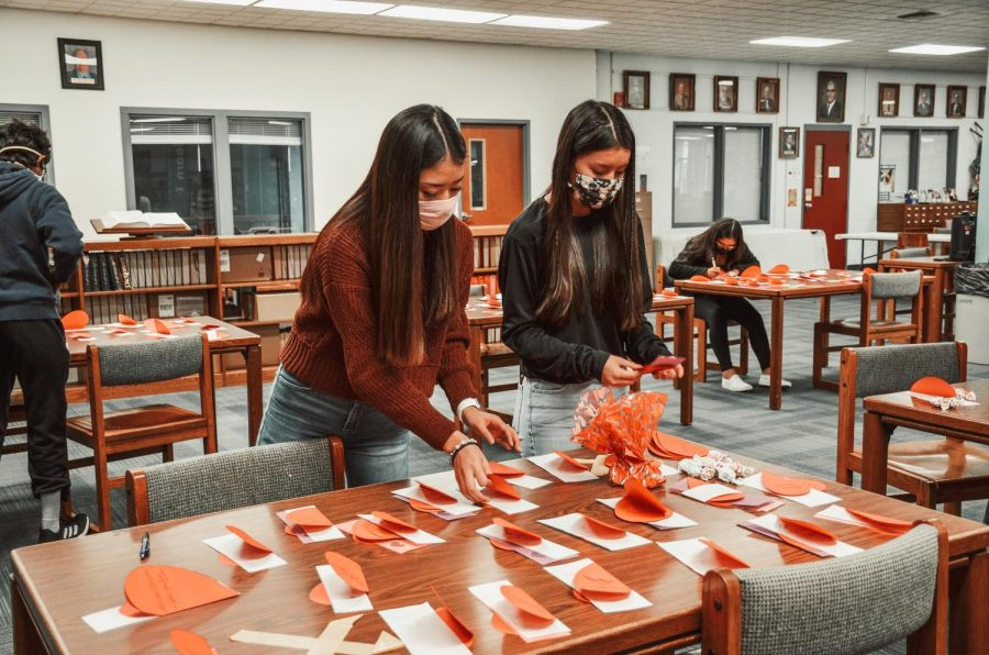 Elaine Au and Sandra Le organize candy grams for the student council last year.