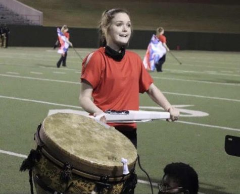 Macy Love is a senior section leader in the color guard this year.