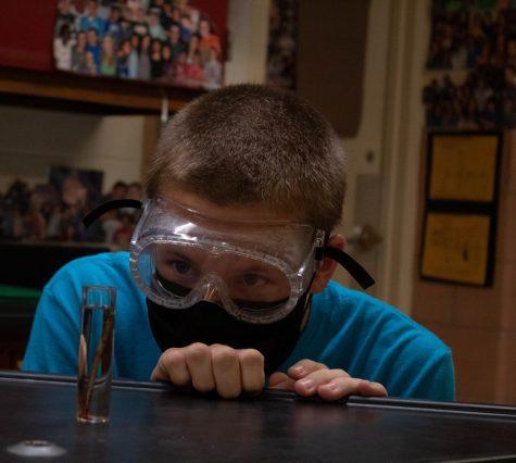 Junior Maverick McKown participates in a lab during a recent Chem Club meeting.